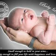 Hold a Newborn Baby in Your Arms