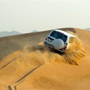 Thunder Through the Sand Dunes Outside Abu Dhabi on a Desert Safari