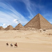See the Great Pyramids of Giza (Only Ancient Wonder Still in Existence)