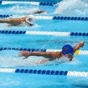 Compete in Swimming Race