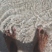 Feel Ocean Waves on Your Feet and Sand Between Your Toes